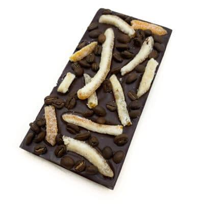 Vegan chocolate block with dark chocolate, chilli powder, candied orange peel and roasted coffee beans